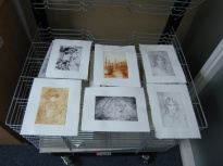 First prints drying. Michael's - bottom left - is from a sketch of Paul Bunyan for the next 'You Read to Me' book.