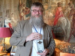 Philip Ardagh looking very happy with a bottle of whiskey!